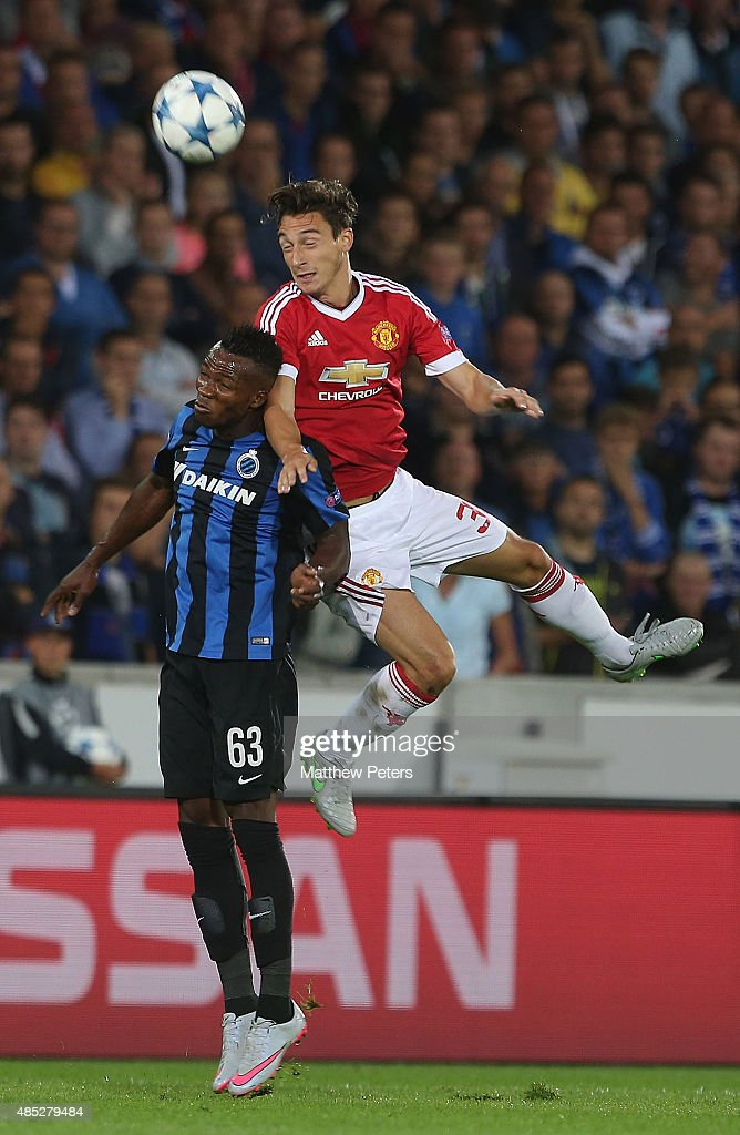 <a gi-track='captionPersonalityLinkClicked' href=/galleries/search?phrase=Matteo+Darmian&family=editorial&specificpeople=7096006 ng-click='$event.stopPropagation()'>Matteo Darmian</a> of Manchester United in action with Bolingoli Mbombo of Club Brugge during the UEFA Champions League play-off second leg match between Club Brugge and Manchester United at Jan Breydel Stadium on August 26, 2015 in Brugge, Belgium.