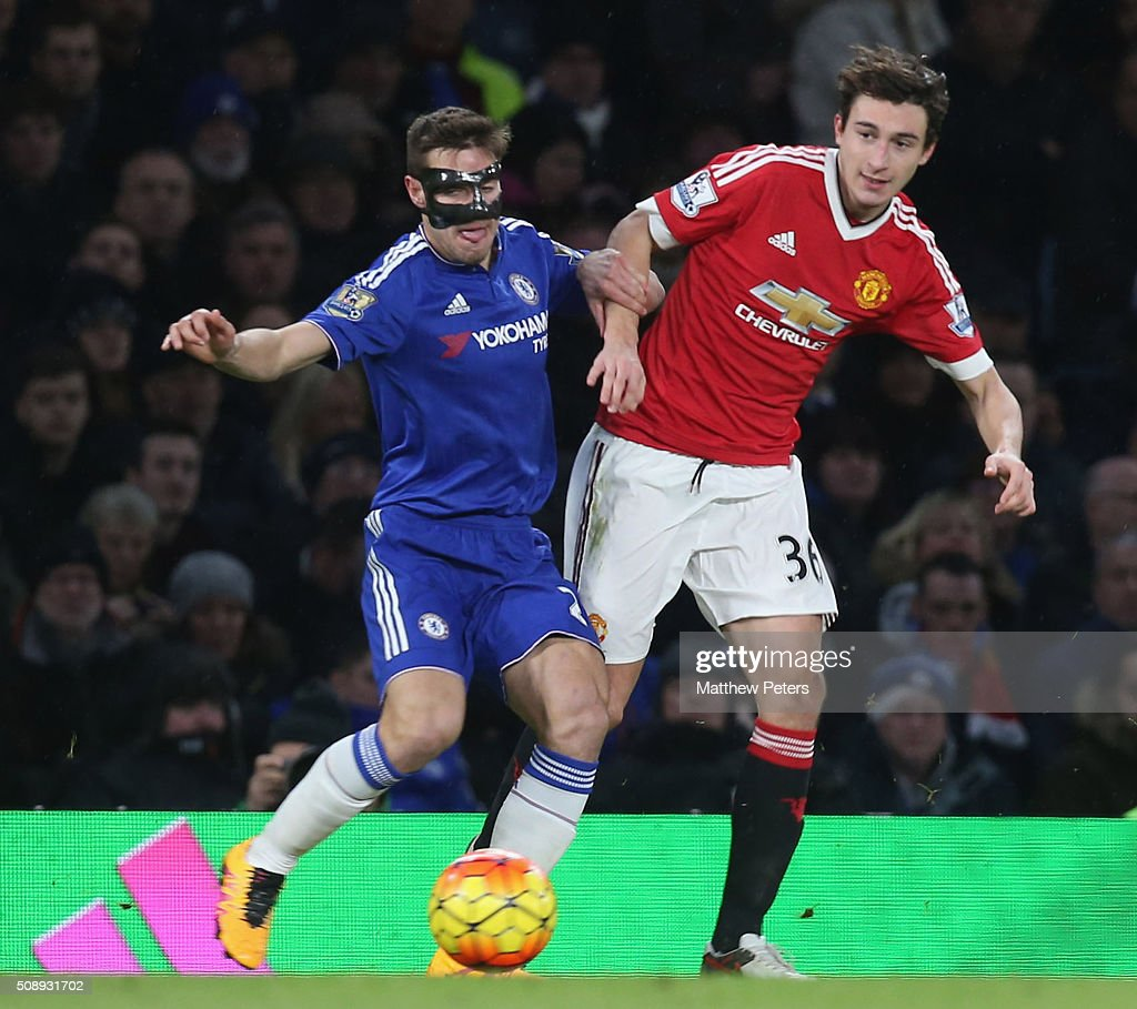 <a gi-track='captionPersonalityLinkClicked' href=/galleries/search?phrase=Matteo+Darmian&family=editorial&specificpeople=7096006 ng-click='$event.stopPropagation()'>Matteo Darmian</a> of Manchester United in action with Cesar Azpilicueta of Chelsea during the Barclays Premier League match between Chelsea and Manchester United at Stamford Bridge on February 7 2016 in London, England.