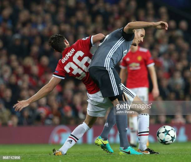 Matteo Darmian of Manchester United in action with Ljubomir Fejsa of Benfica during the UEFA Champions League group A match between Manchester United...