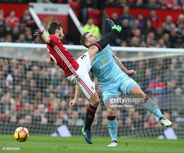 Matteo Darmian of Manchester United in action with Sam Vokes of Burnley during the Premier League match between Manchester United and Burnley at Old...
