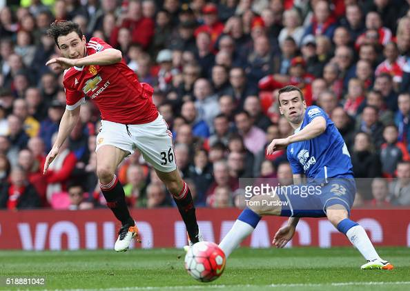 Matteo Darmian of Manchester United in action with Seamus Coleman of Everton during the Barclays Premier League match between Manchester United and...