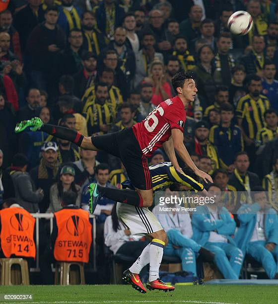 Matteo Darmian of Manchester United in action with Volken Sen of Fenerbahce during the UEFA Europa League match between Manchester United and...