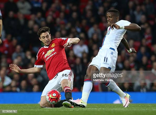 Matteo Darmian of Manchester United in action with Wilfried Zaha of Crystal Palace during the Barclays Premier League match between Manchester United...