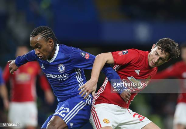 Matteo Darmian of Manchester United in action with Willian of Chelsea during the Emirates FA Cup QuarterFinal match between Chelsea and Manchester...