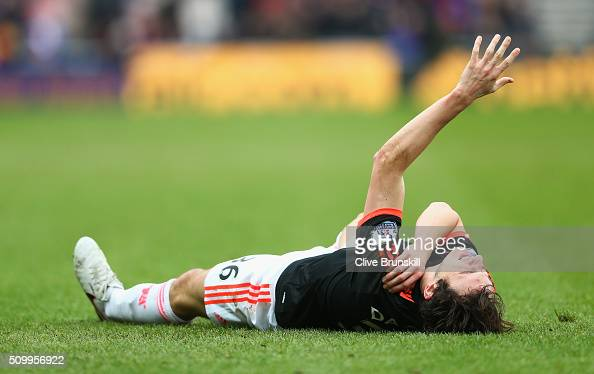 Matteo Darmian of Manchester United lies injured during the Barclays Premier League match between Sunderland and Manchester United at the Stadium of...