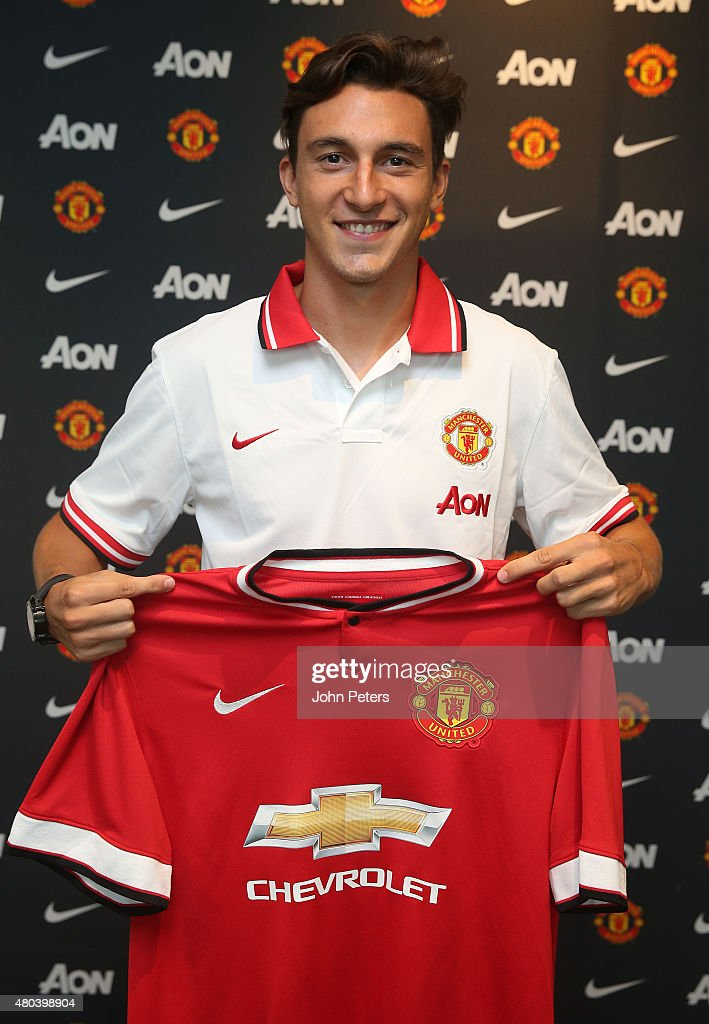 Matteo Darmian of Manchester United poses after signing for the club at Aon Training Complex on July 11, 2015 in Manchester, England.