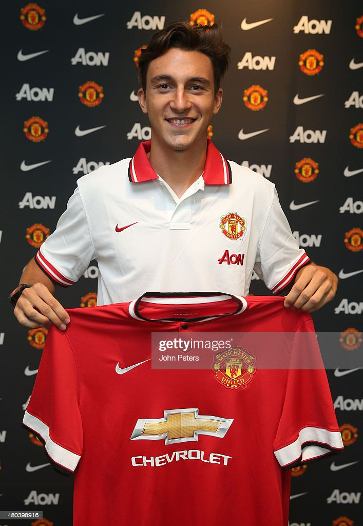 <a gi-track='captionPersonalityLinkClicked' href=/galleries/search?phrase=Matteo+Darmian&family=editorial&specificpeople=7096006 ng-click='$event.stopPropagation()'>Matteo Darmian</a> of Manchester United poses after signing for the club at Aon Training Complex on July 11, 2015 in Manchester, England.