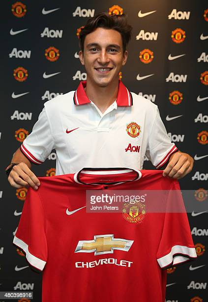 Matteo Darmian of Manchester United poses after signing for the club at Aon Training Complex on July 11 2015 in Manchester England