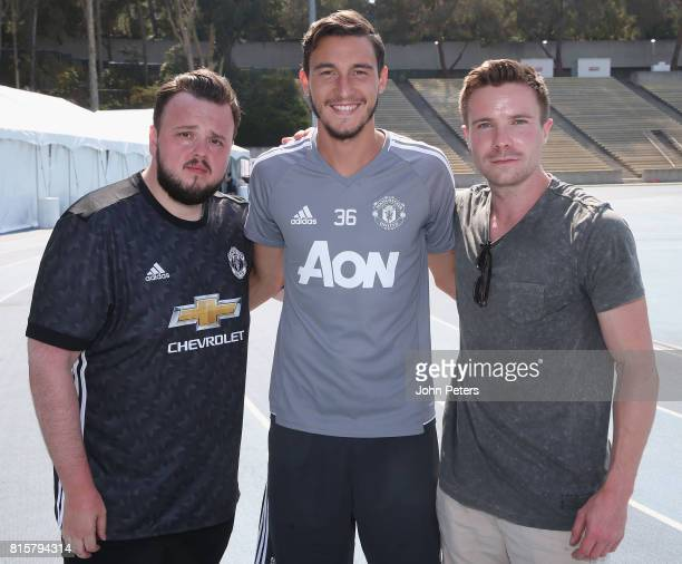 Matteo Darmian of Manchester United poses with Game of Thrones actors John BradleyWest and Joe Dempsie ahead of a first team training session as part...