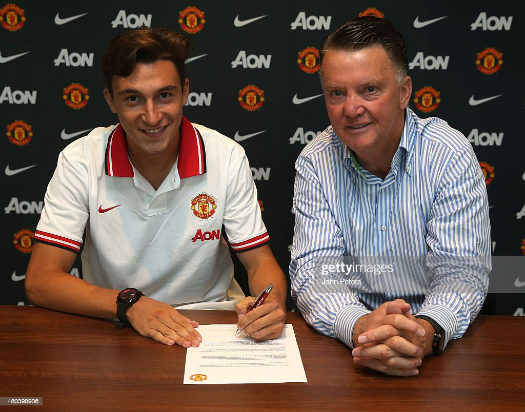 Matteo Darmian of Manchester United poses with Manager Louis van Gaal after signing for the club at Aon Training Complex on July 11, 2015 in Manchester, England.