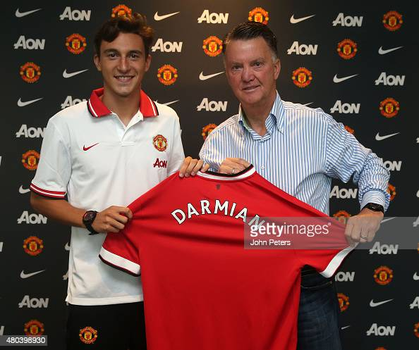Matteo Darmian of Manchester United poses with Manager Louis van Gaal after signing for the club at Aon Training Complex on July 11 2015 in...