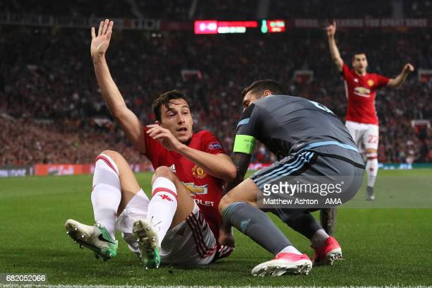 Matteo Darmian of Manchester United reacts to a challenge from Hugo Mallo of Celta Vigo during the UEFA Europa League semi final second leg match...