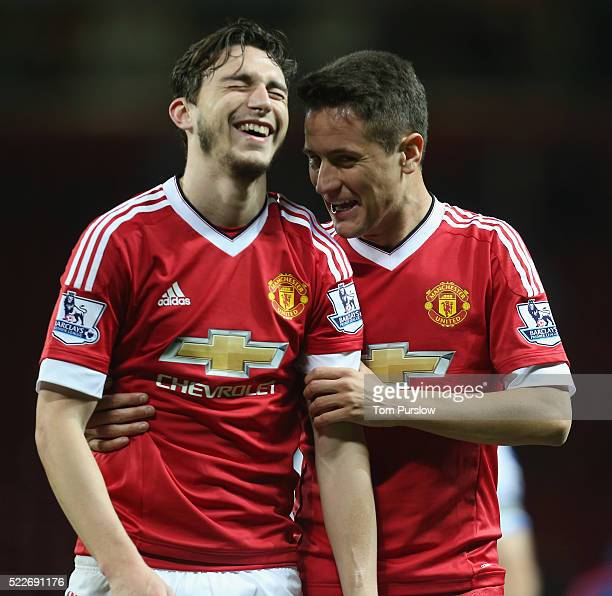 Matteo Darmian of Manchester United shares a joke with Ander Herrera after the Barclays Premier League match between Manchester United and Crystal...