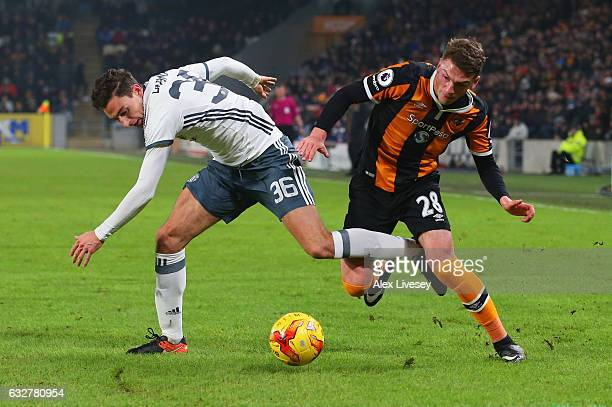 Matteo Darmian of Manchester United tangles with Josh Tymon of Hull City during the EFL Cup SemiFinal second leg match between Hull City and...