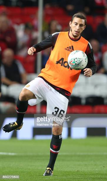 Matteo Darmian of Manchester United warms up ahead of the Carabao Cup Third Round between Manchester United and Burton Albion at Old Trafford on...