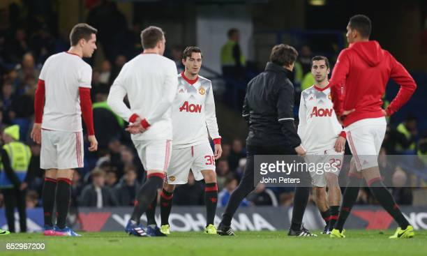 Matteo Darmian of Manchester United warms up ahead of the Emirates FA Cup QuarterFinal match between Chelsea and Manchester United at Stamford Bridge...