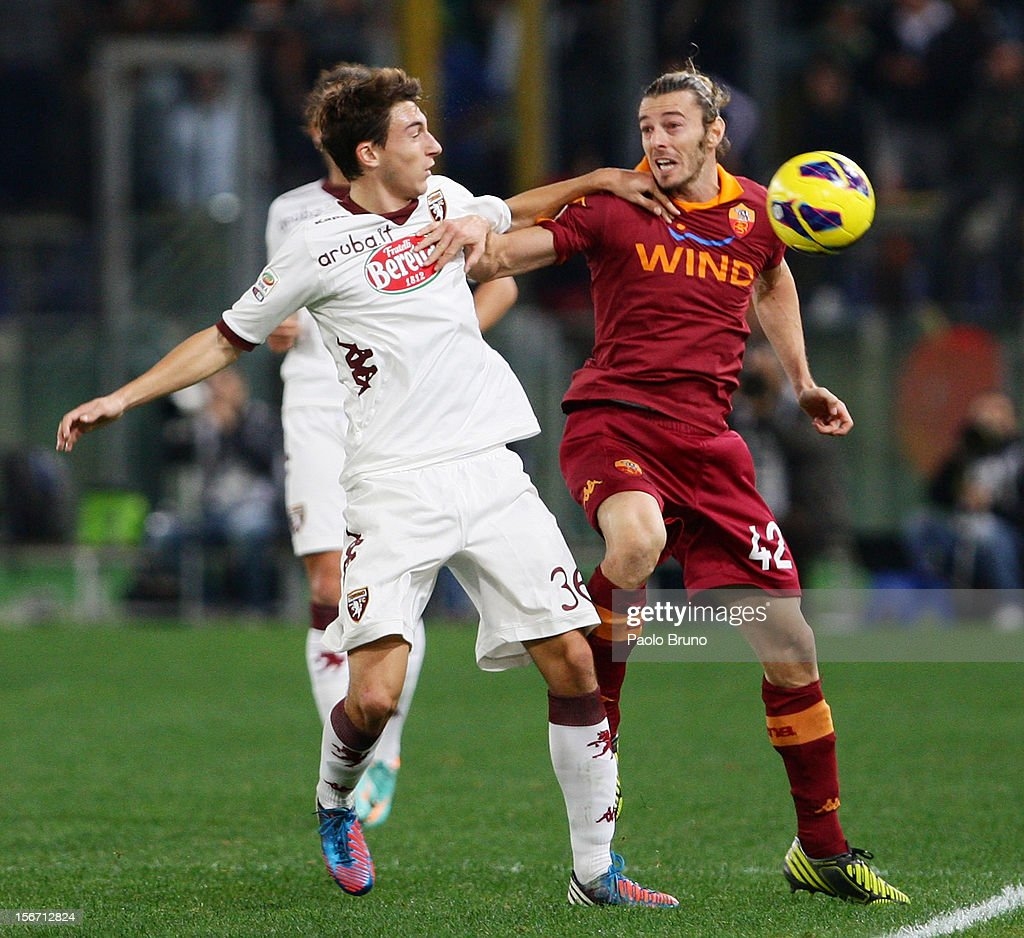 Matteo Darmian of Torino FC competes for the ball with <a gi-track='captionPersonalityLinkClicked' href=/galleries/search?phrase=Federico+Balzaretti&family=editorial&specificpeople=686070 ng-click='$event.stopPropagation()'>Federico Balzaretti</a> (R) of AS Roma during the Serie A match between AS Roma and Torino FC at Stadio Olimpico on November 19, 2012 in Rome, Italy.