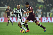 Matteo Darmian of Torino FC in action against Carlos Tevez of Juventus FC during the Serie A match between Juventus FC and Torino FC at Juventus...