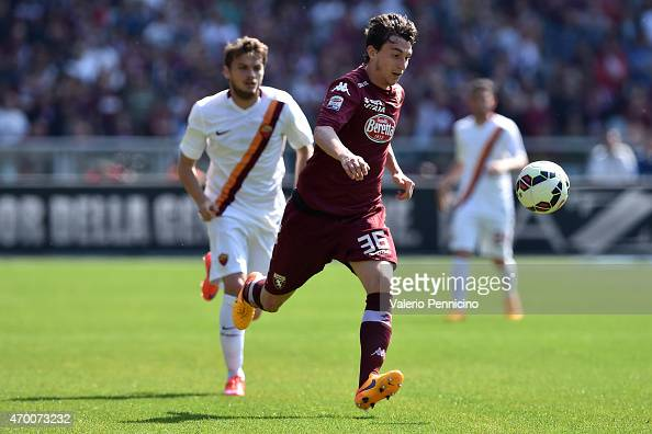 Matteo Darmian of Torino FC in action during the Serie A match between Torino FC and AS Roma at Stadio Olimpico di Torino on April 12 2015 in Turin...