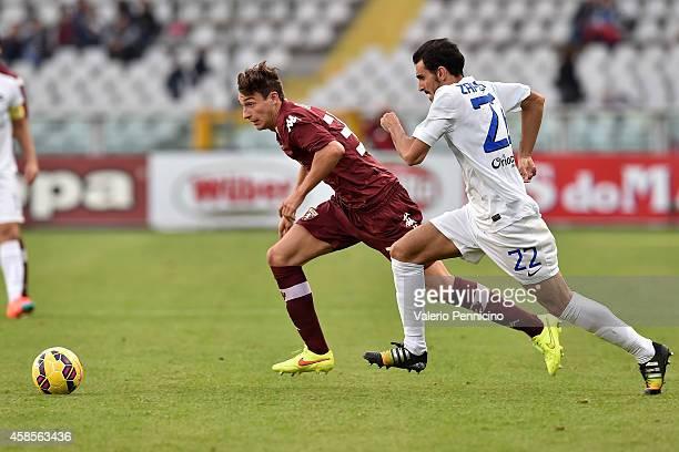 Matteo Darmian of Torino FC runs of Davide Zappacosta of Atalanta BC during the Serie A match between Torino FC and Atalanta BC at Stadio Olimpico on...