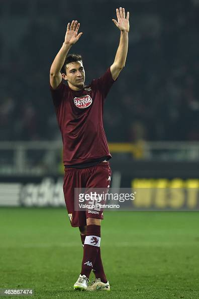 Matteo Darmian of Torino FC salutes the fans at the end of the UEFA Europa League Round of 32 match between Torino FC and Athletic Club on February...