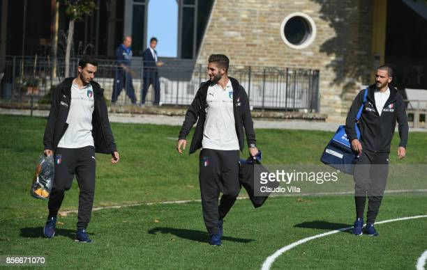 Matteo Darmian Roberto Gagliardini and Leonardo Bonucci of Italy chat during a training session at Italy club's training ground at Coverciano on...