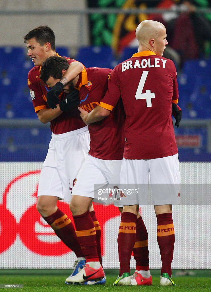 Matteo Destro (C) with his teammates of AS Roma celebrate after scoring his third team's goal during the TIM Cup match between AS Roma and Atalanta BC at Olimpico Stadium on December 11, 2012 in Rome, Italy.