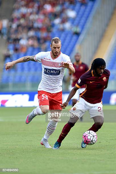 Matteo Fedele challenges Gervinho during the Italian Serie A match between AS Roma and FC Carpi at Stadio Olimpico in Rome on September 26 2015