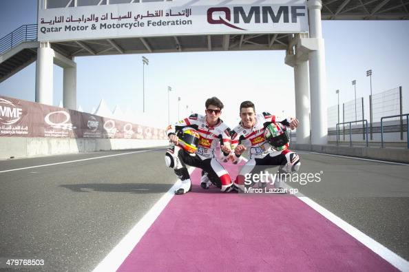 Matteo Ferrari of Italy and San Carlo Team Italia and Andrea Locatelli of Italy and san Carlo Team Italia pose in pit during the MotoGp of Qatar Free...