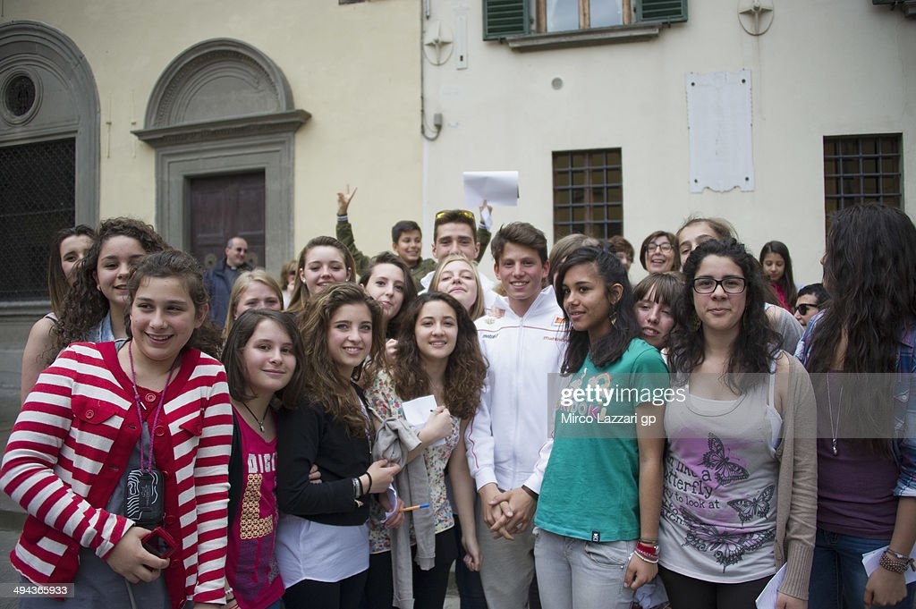 Matteo Ferrari of Italy and San Carlo Team Italia and Andrea Locatelli of Italy and san Carlo Team Italia poses with fans during the preevent...