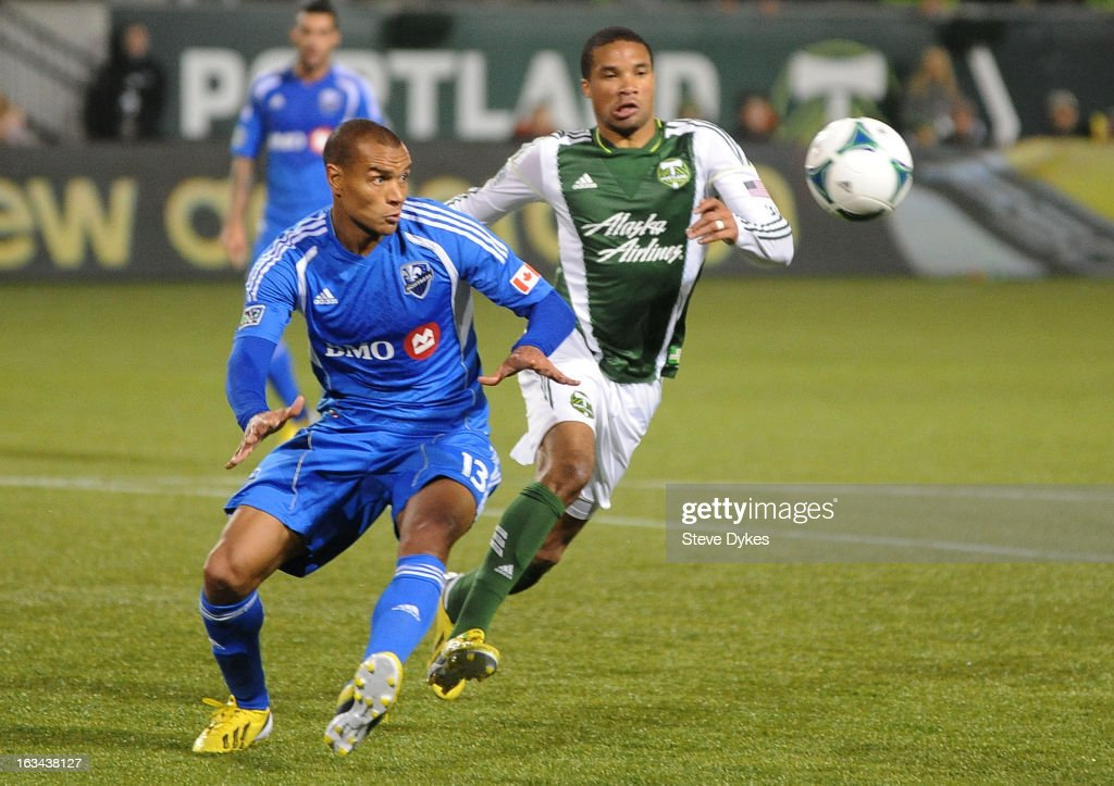 Matteo Ferrari #13 of Montreal Impact and Ryan Johnson #9 of Portland Timbers go after a ball during the second half of the game at Jeld-Wen Field on March 09, 2013 in Portland, Oregon. Montreal won the game 2-1.