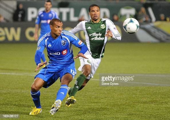 Matteo Ferrari of Montreal Impact and Ryan Johnson of Portland Timbers go after a ball during the second half of the game at JeldWen Field on March...