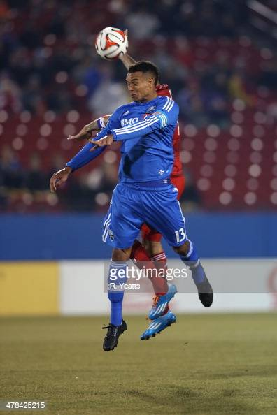 Matteo Ferrari of Montreal Impact defends the ball from the FC Dallas defense at Toyota Stadium on March 8 2014 in Frisco Texas
