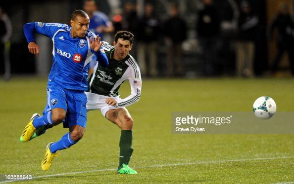Matteo Ferrari of Montreal Impact goes after a ball with Diego Valeri of Portland Timbers moves up the field with the ball during the second half of...