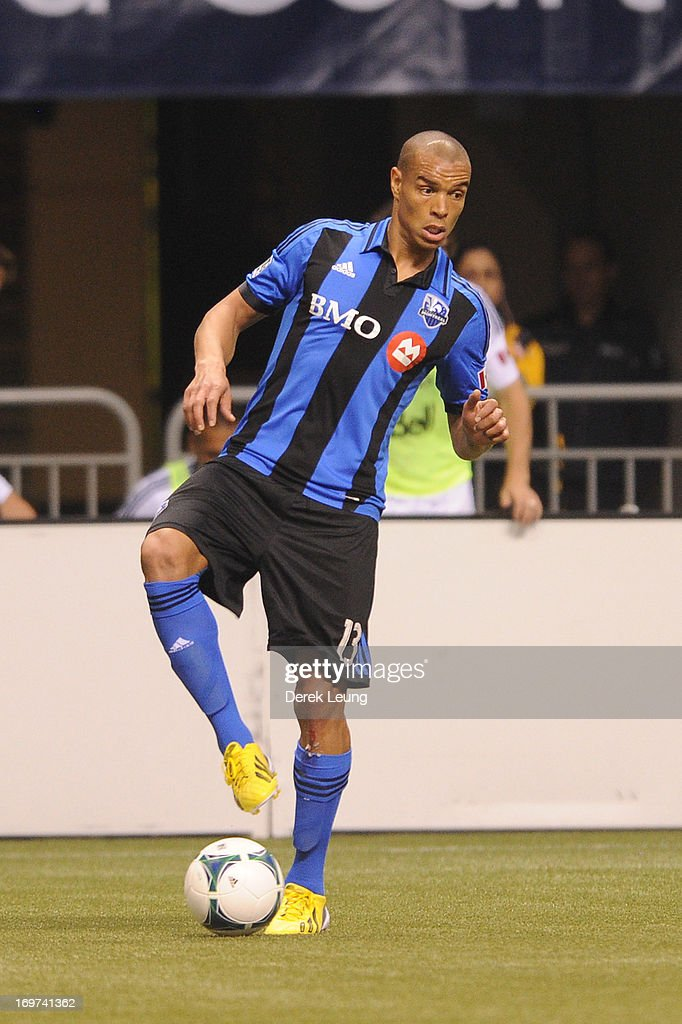 Matteo Ferrari of the Montreal Impact runs against the Vancouver Whitecaps during the finals of the Amway Canadian Championship at BC Place on May 29...