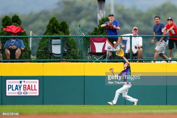 Matteo Gerali of the Europe Africa team from Italy makes a catch during Game 3 of the 2017 Little League World Series against the Canada team from...