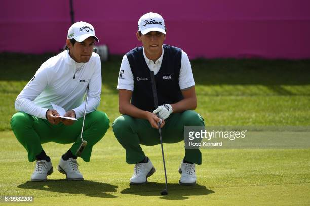 Matteo Manassero and Renato Paratore of Italy line up on the 6th green during the quarter final match between England and Italy during day two of...