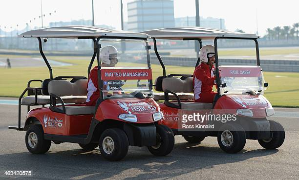 Matteo Manassero of Italy and Paul Casey of England during the 'Buggy Race' at the Yas Marina Circuit prior to the Abu Dhabi HSBC Golf Championship...