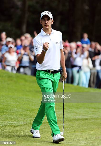 Matteo Manassero of Italy celebrates after chipping in from rough on the thirteenth green during the final round of the BMW PGA Championship on the...