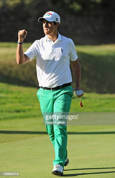 Matteo Manassero of Italy celebrates his birdie putt on the 15th hole during the final round of the Castello Masters Costa Azahar at the Club de...