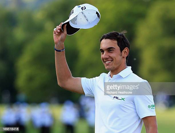 Matteo Manassero of Italy celebrates victory on the eighteenth green after the fourth playoff hole during the final round of the BMW PGA Championship...