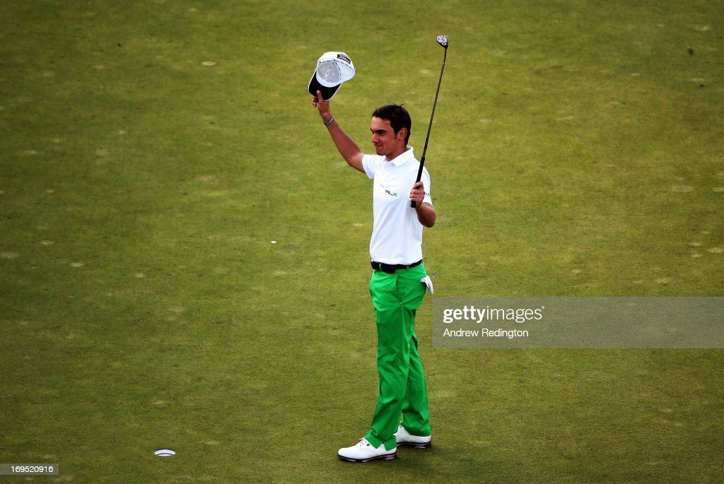 Matteo Manassero of Italy celebrates victory on the eighteenth green after the fourth play-off hole during the final round of the BMW PGA Championship on the West Course at Wentworth on May 26, 2013 in Virginia Water, England.