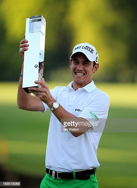 Matteo Manassero of Italy celebrates with the trophy on the eighteenth green after winning the fourth playoff hole during the final round of the BMW...