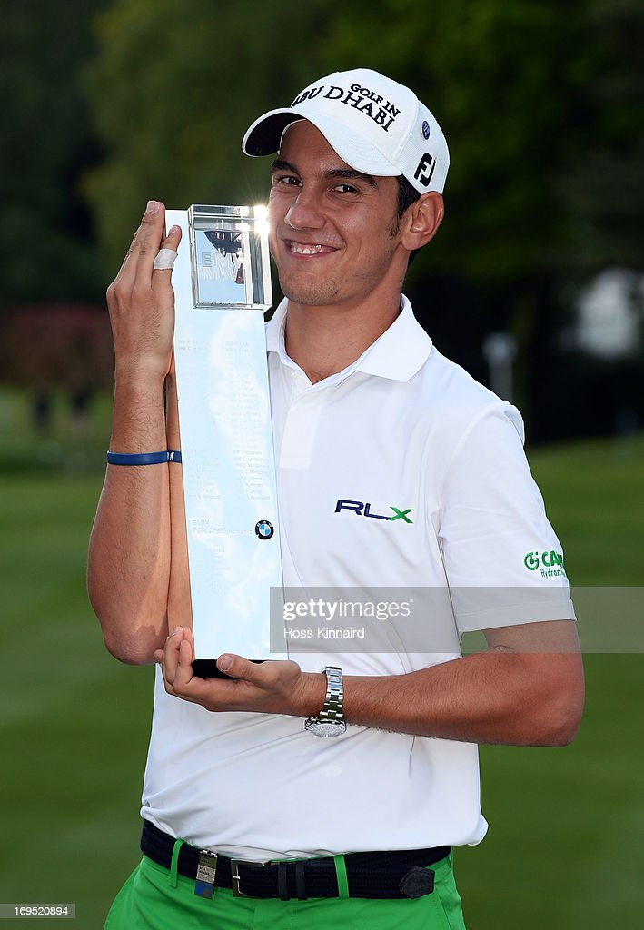 <a gi-track='captionPersonalityLinkClicked' href=/galleries/search?phrase=Matteo+Manassero&family=editorial&specificpeople=4479535 ng-click='$event.stopPropagation()'>Matteo Manassero</a> of Italy celebrates with the trophy on the eighteenth green after winning the fourth play-off hole during the final round of the BMW PGA Championship on the West Course at Wentworth on May 26, 2013 in Virginia Water, England.