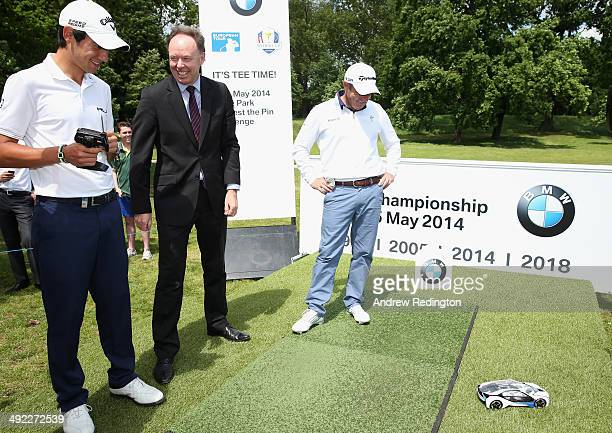 Matteo Manassero of Italy DrIan Robertson Member of the Board of Manangement of BMW AG and Paul McGinley of Ireland play with the remote control car...