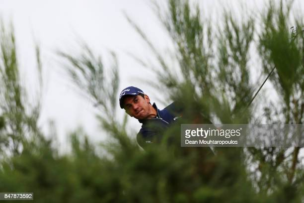 Matteo Manassero of Italy hits his third shot on the 1st hole from the bushes during day 3 of the European Tour KLM Open held at The Dutch on...