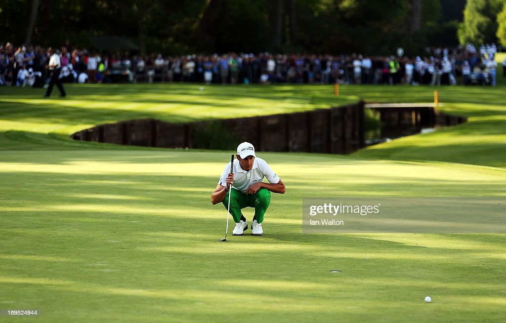 Matteo Manassero of Italy lines up a putt on the eighteenth green in the play-off during the final round of the BMW PGA Championship on the West Course at Wentworth on May 26, 2013 in Virginia Water, England.