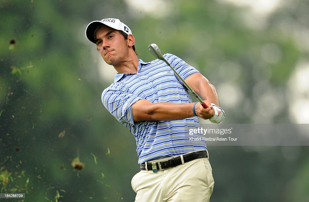 <a gi-track='captionPersonalityLinkClicked' href=/galleries/search?phrase=Matteo+Manassero&family=editorial&specificpeople=4479535 ng-click='$event.stopPropagation()'>Matteo Manassero</a> of Italy plays a shot during round two of the Maybank Malaysian Open at Kuala Lumpur Golf & Country Club on March 22, 2013 in Kuala Lumpur, Malaysia.
