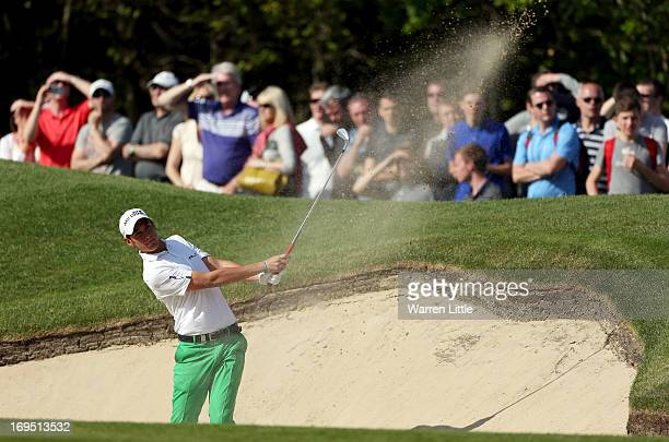 Matteo Manassero of Italy plays from a bunker during the final round of the BMW PGA Championship on the West Course at Wentworth on May 26 2013 in...