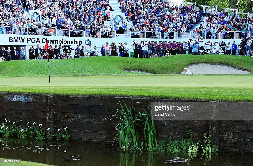Matteo Manassero of Italy plays from a bunker on the eighteenth green in the play-off during the final round of the BMW PGA Championship on the West Course at Wentworth on May 26, 2013 in Virginia Water, England.
